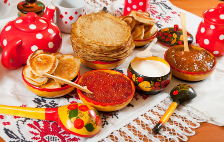 Russian Shrovetide meal - pancake with caviar and tea photo