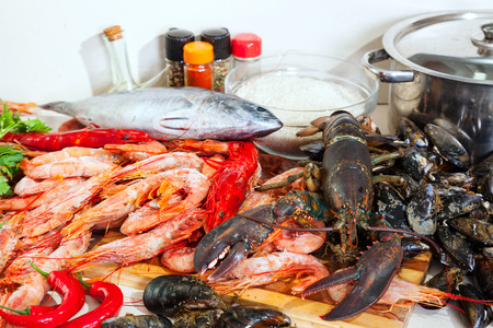 lobster pot: Fresh raw marine products in domestic kitchen