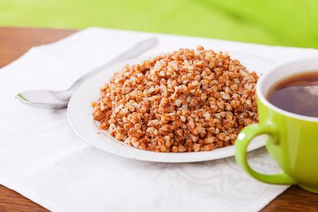 kasha: boiled buckwheat porridge closeup on table Stock Photo