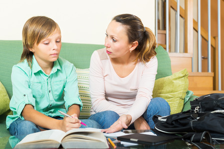 unclear: Mother explaining son unclear questions on homework
