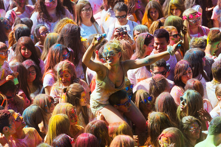 BARCELONA, SPAIN - APRIL 12, 2015: Happy people at Festival of colours Holi Barcelona. Holi is traditional holiday of Indian culture
