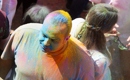 colores: BARCELONA, SPAIN - APRIL 12, 2015: Man at  Festival de los colores Holi in Barcelona. Holi is traditional holiday of India Editorial