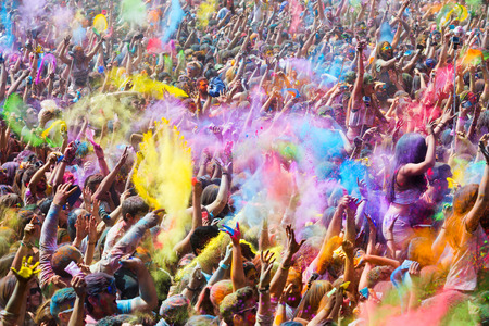 traditional festivals: BARCELONA, SPAIN - APRIL 12, 2015: Happy people during   Festival of colours Holi. Holi is traditional holiday of India Editorial
