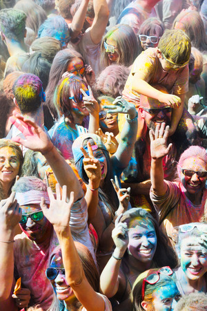 trituration: BARCELONA, SPAIN - APRIL 12, 2015: Happy people during   Festival of colours Holi. Holi is traditional holiday of India Editorial