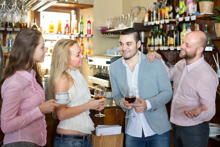 acquaintance: Casual acquaintance of young happy adults at bar. Selective focus Stock Photo