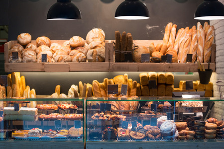 retail: Modern bakery with different kinds of bread, cakes and buns