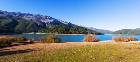 Mountains landscape with river.  Isla Cabeza de la Vina - Guadalquivir river, Andalusia