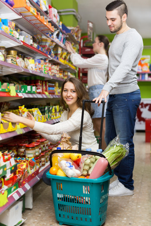People purchasing a food for week at supermarket photo