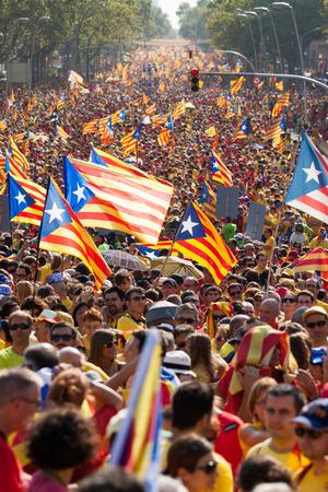 demonstrators: BARCELONA, SPAIN - SEPTEMBER 11, 2014:  Rally demanding independence for Catalonia  (Diada Nacional de Catalunya) in 300th anniversary of loss of independence of Catalonia in Barcelona