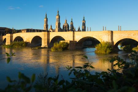 zaragoza: Medieval stone bridge in sunny morning. Zaragoza Stock Photo