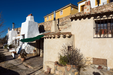 dwellings: Dwellings  caves built  into mount.  Chinchilla de Monte-Aragon, Spain