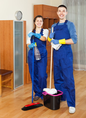 houseman: Two smiling cleaners cleaning floor in room Stock Photo