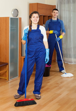 company premises: Cleaners team cleaning floor in room