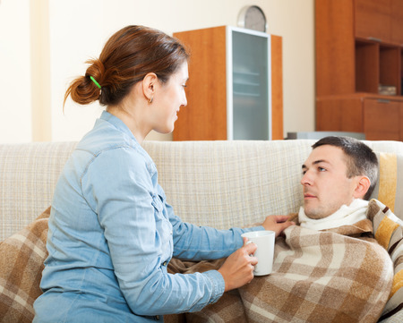 caring for: Loving woman caring for sick husband in home