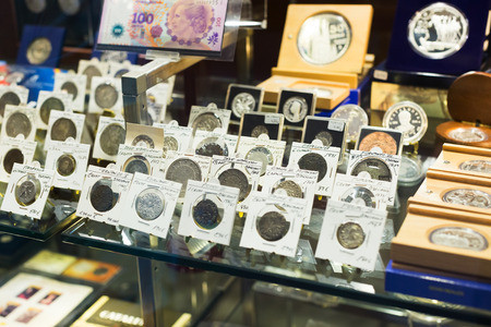numismatics: BARCELONA, SPAIN - OCTOBER 28, 2014: Coins on counter at numismatics store Editorial