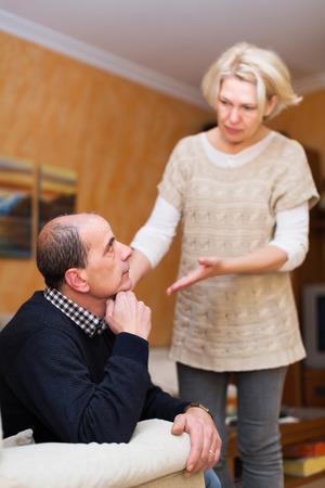 flatter: Guilty senior wife asking husband for forgiveness Stock Photo