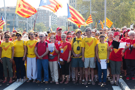 demanding: BARCELONA, SPAIN - SEPTEMBER 11, 2014: Crowd of people singing at rally demanding independence for Catalonia