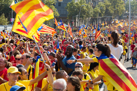 demanding: BARCELONA, SPAIN - SEPTEMBER 11, 2014: Crowd of people  at rally demanding independence for Catalonia. Barcelona, Spain Editorial