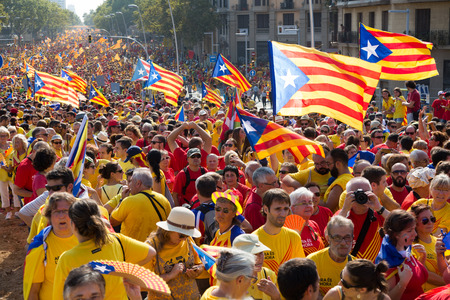 demonstrators: BARCELONA, SPAIN - SEPTEMBER 11, 2014: People at  rally to 300th anniversary of  loss of independence of Catalonia Editorial