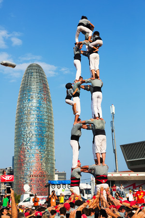 independency: BARCELONA, SPAIN - SEPTEMBER 11, 2014: Castellers performing Castells in National Day of Catalonia.  Castell - Catalan show is human tower built