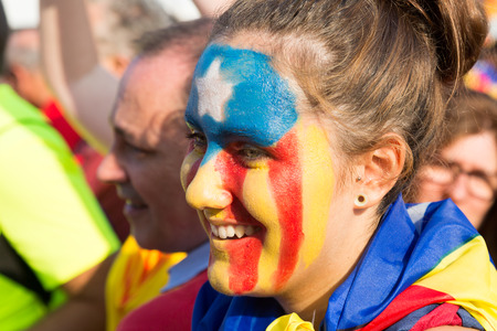 independency: BARCELONA, SPAIN - SEPTEMBER 11, 2014: Unidentified Catalan young girl with  pattern of the pro-independence flag participate in the National Day of Catalonia, Barcelona