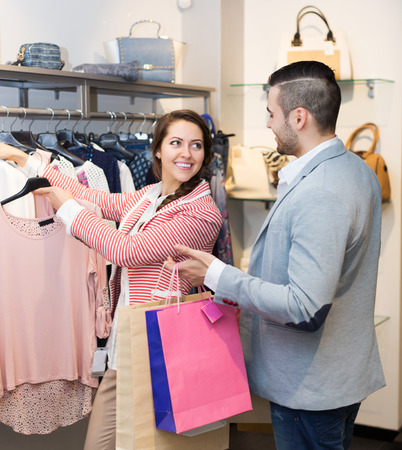 spouses: Positive young spouses smiling while shopping at boutique