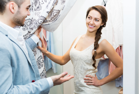 spouses: Happy beauty spouses standing at boutique changing cubicle