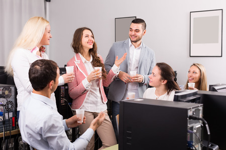 satisfied people: Group of satisfied  people drinking champagne at office Stock Photo
