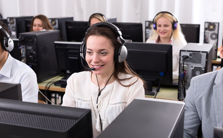call center woman: Working process of successful call center team at office and cheerful woman Stock Photo