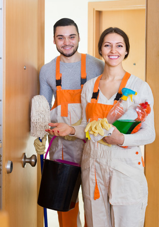 houseman: Cleaning premises team is ready to work at clients home. Focus on girl Stock Photo