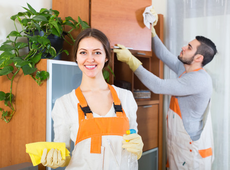 houseman: Professional hardworking cleaners cleaning in room