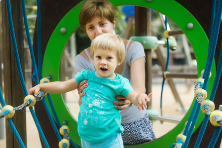 deftness: Baby girl with mother at   playground in summer