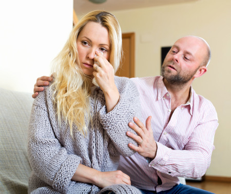 fracas: Man asking for forgiveness from sad woman