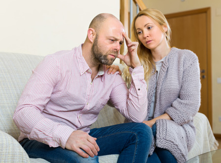 to reassure: Loving woman tries reconcile with man after quarrel. Focus on guy