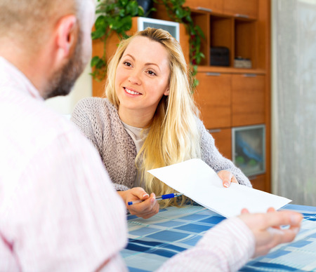 real estate contract: Husband and wife reading insurance contract and smiling Stock Photo