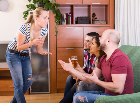 jokes: Positive american friends hanging out with beer and jokes at home