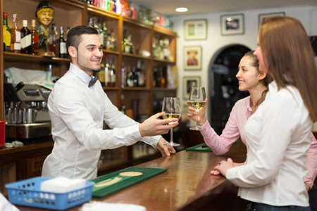 30 years old: female friends 30 years old chatting and drinking wine in bar Stock Photo