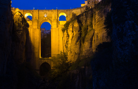 ronda: stone bridge  in night.  Ronda, Spain