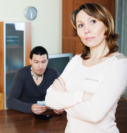 financial problems: Financial problems in family. Sad woman against man with money
