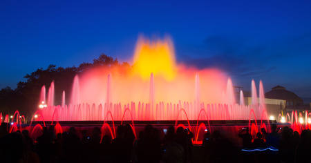gazer: Evening view at colorful vocal Montjuic fountain in Barcelona. Catalonia, Spain