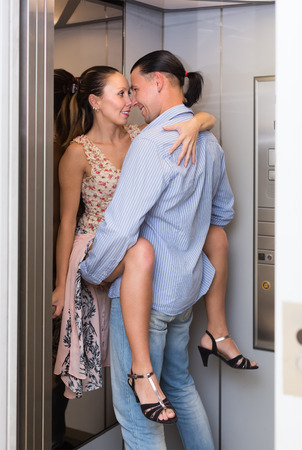adult sex: Impatient happy adult couple of lovers having sex at elevator