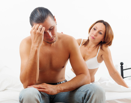 man and woman sex: man has problem, wife comforting him in bed