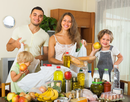tinned goods: Happy smiling family with two children came back from supermarket