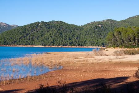 vino: Mountains river with island. Isla Cabeza de la Vino - Guadalquivir river, Andalusia,  Spain Stock Photo