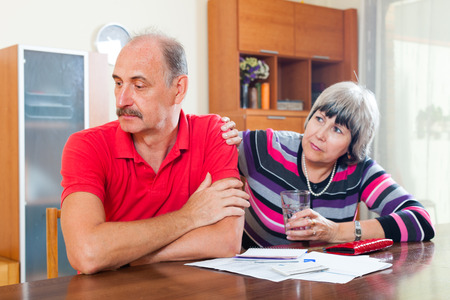 parsimony: Financial problems in the family. Mature woman asks for money from her husband for the credit