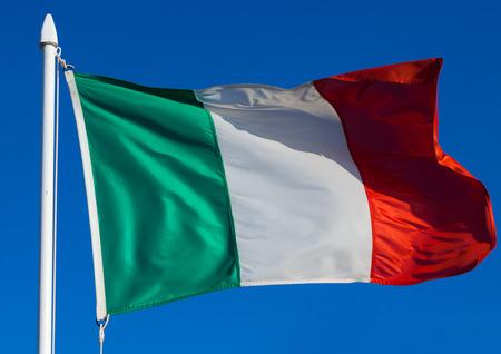 italian politics: Flag of Italy against blue sky Stock Photo