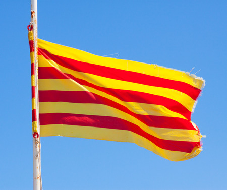 independency: flying  flag of Catalonia against blue sky