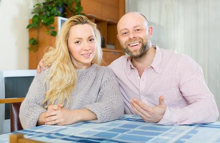gladful: Portrait of positive smiling loving couple indoor