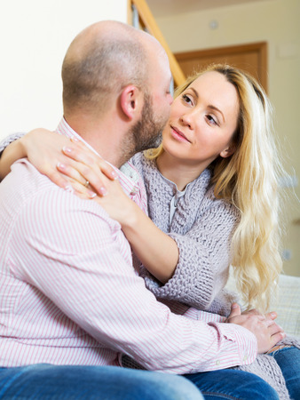 gladful: Portrait happy loving couple in home interior