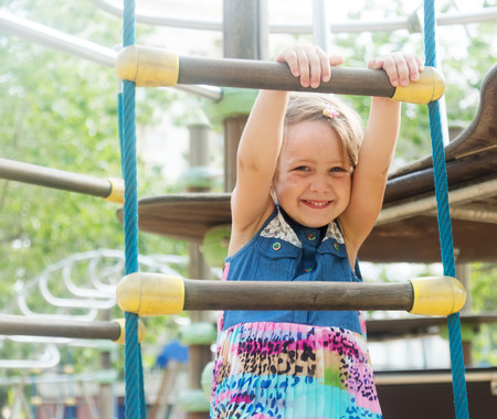 deftness: Girl at action-oriented playground in park